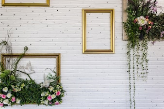 Vintage frames on white brick wall. background.