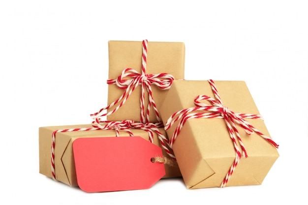Vintage gift boxes with blank gift tag isolated on white .