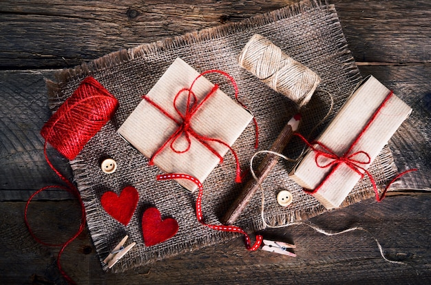 Vintage gift boxes with blank gift tag on old wooden.