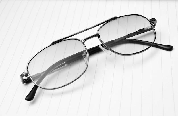 Vintage glasses on paper background