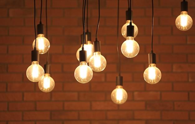 Vintage glowing light bulbs hanging.