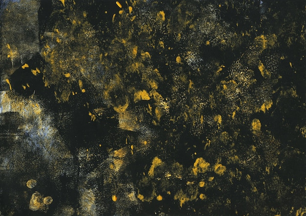 Vintage gold and black texture. abstract splattered background. modern art with bronze acrylic paint brush strokes on dark paper canvas