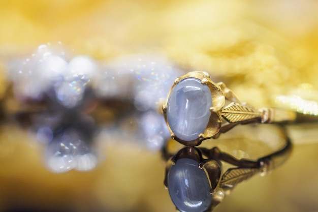 Vintage gold jewelry blue sapphire rings with reflection
