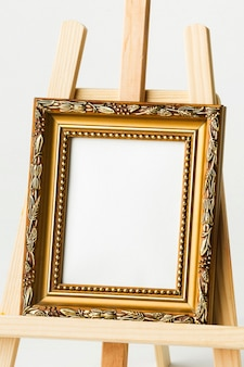 Vintage golden frame on easel