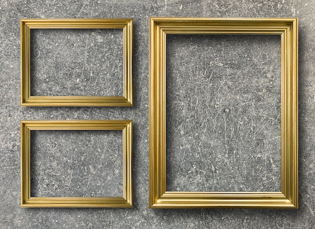Vintage golden picture frame on rust cement wall