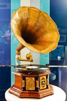 Vintage gramophone and platter on colorful background