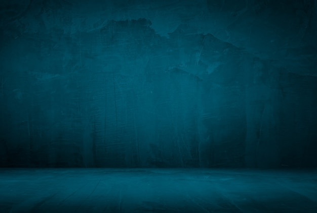 Vintage grunge blue concrete texture studio wall background with vignette.
