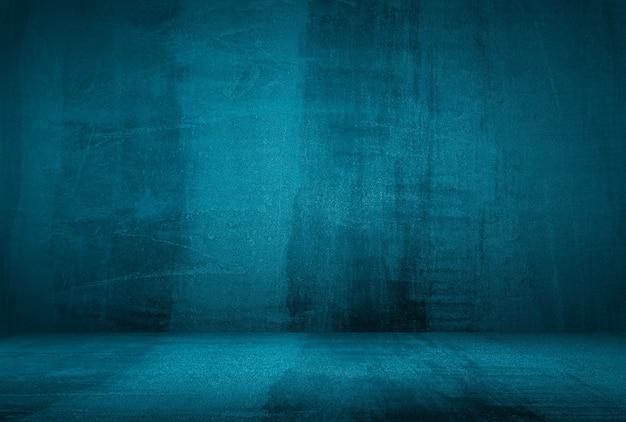 ビネットとヴィンテージグランジブルーコンクリートテクスチャスタジオ壁の背景。