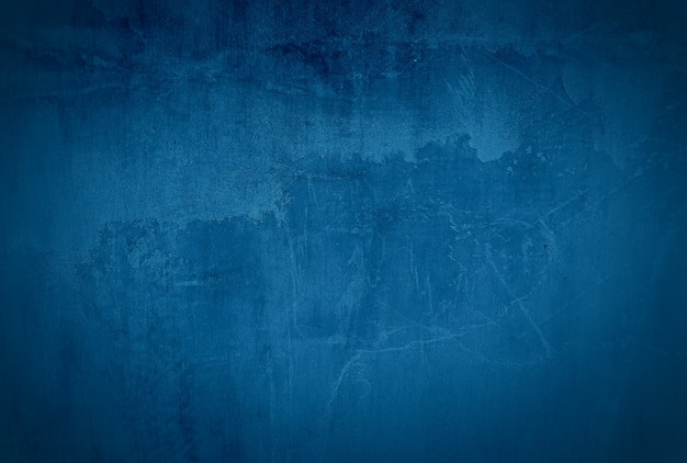 Vintage grunge blue concrete texture wall background with vignette.