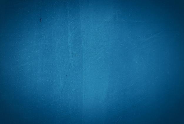 ビネットとヴィンテージグランジブルーコンクリートテクスチャ壁の背景。