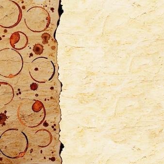 表面のコーヒーカップの痕跡とコーヒーの染みとヴィンテージグランジ焦げた紙のテクスチャ