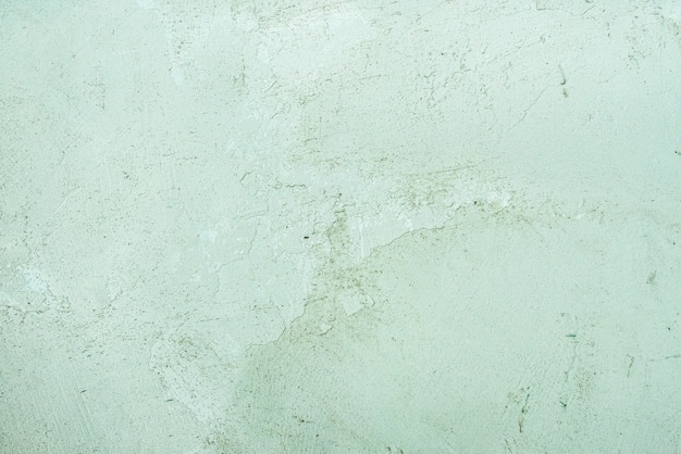 Vintage or grungy celadon green background of natural cement or stone old texture as a retro pattern wall. grunge, material, aged, construction.