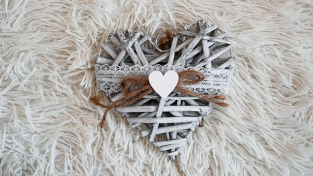 Vintage handmade heart on the soft white blanket. romantic love, valentines day concepts.