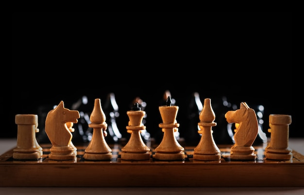 Vintage handmade wooden chess board and figures