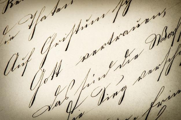 ヴィンテージの手書き。アンティーク原稿。古紙の背景。レトロなスタイルのトーンの写真