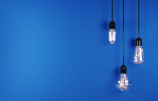 Vintage hanging light bulb on blue background