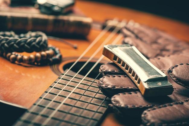 Vintage harmonica on acoustic guitar