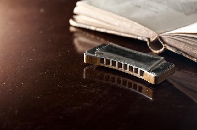 Vintage harmonica on wooden desk