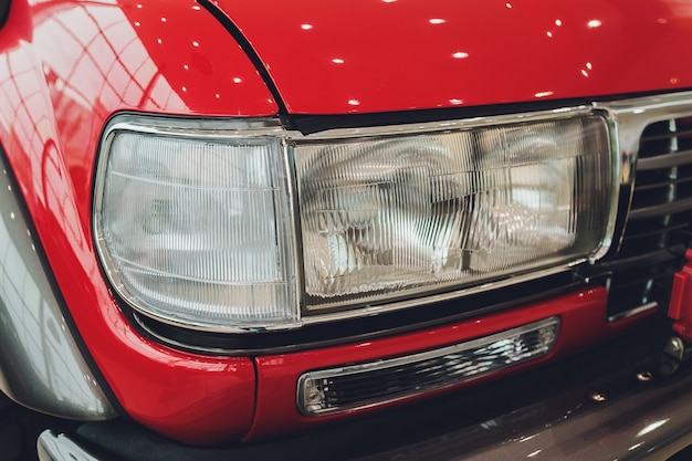 Vintage headlights on square body truck close-up.