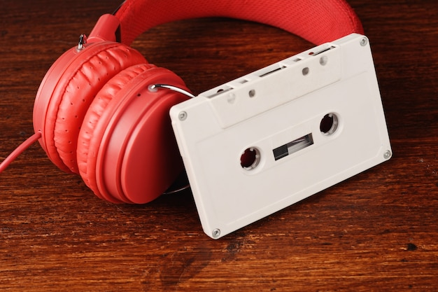 Vintage headphones and audio cassette