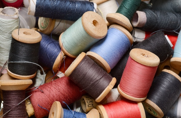 Vintage hipster plenty multicolor threads bobbins top view. atelier, sewing accessories
