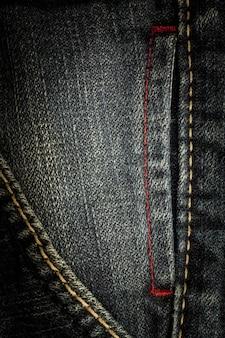 Текстура линии шитья винтажных джинсов
