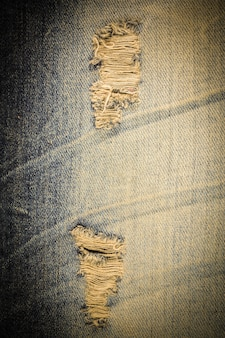 Vintage jeans torn denim texture.