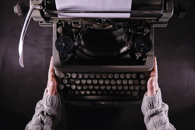Vintage journalist tool. typewriter retro. the writer is at work. seal of the novel. journalist writer concept.