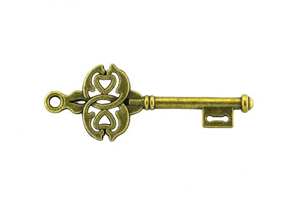 Vintage key on white background