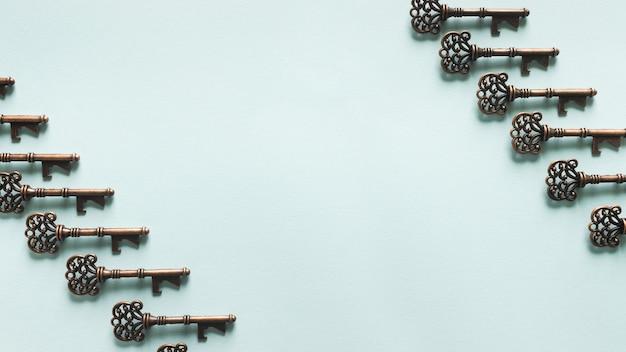 Vintage keys pattern on blue background