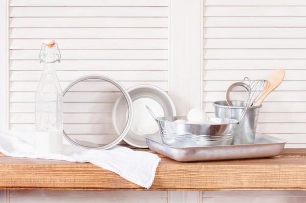Vintage kitchen utensils on the wooden shelf