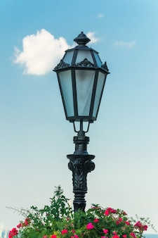 Vintage lamp post with flower bed close up