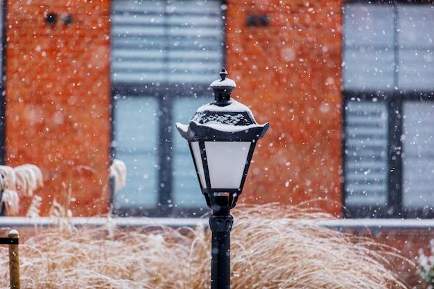 Vintage lamp in snow white snowfall