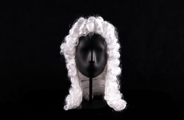 Vintage lawyer wig isolated on black background