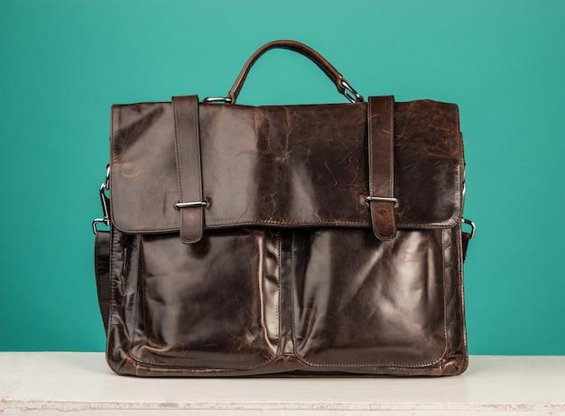 Vintage leather briefcase on blue