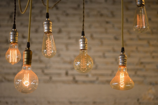 Vintage light bulb in modern coffee shop or restaurant