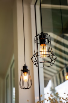Vintage light bulbs hanging from ceiling decorated in the room.