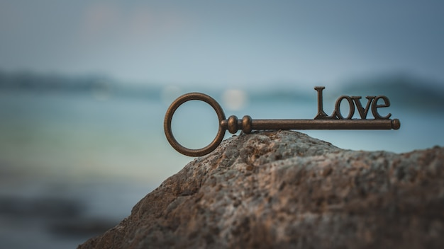 Vintage love key on sea stone