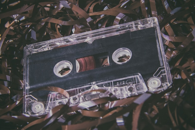 Vintage magnetic audio cassette against film