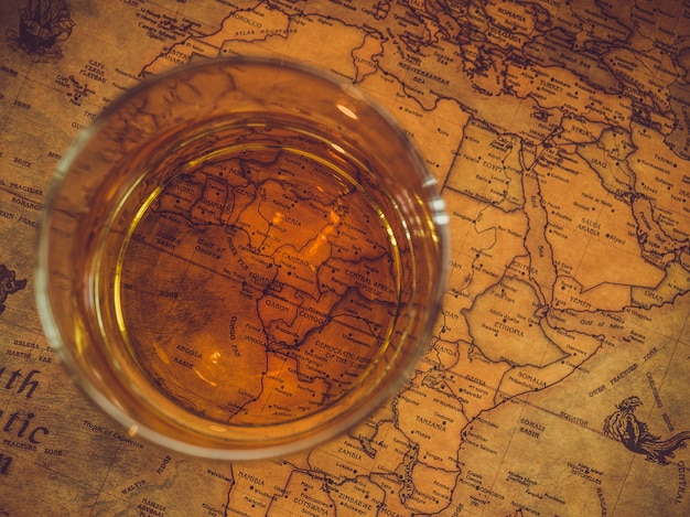 Vintage map and a glass of whiskey