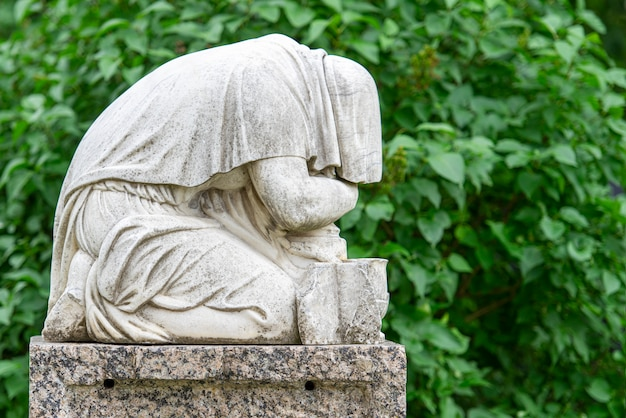 Vintage marble statue at an old graveyard or cemetery