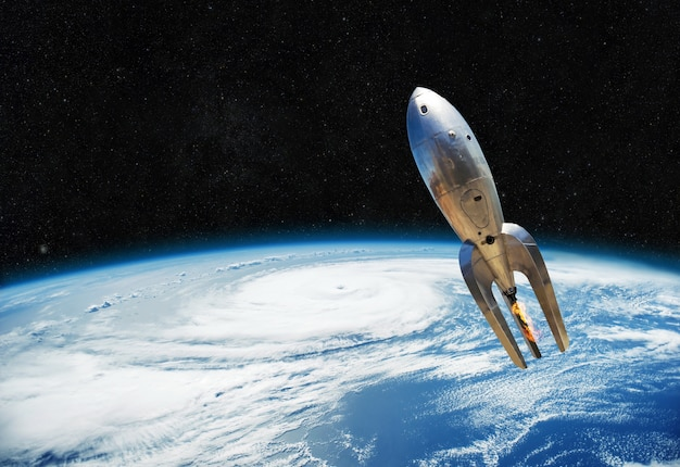 Vintage metal spaceship is flying near the earth. beginning of the space way