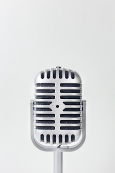 The vintage microphone close up image on white background.
