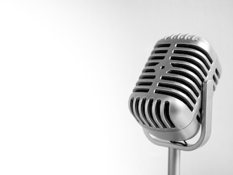 Vintage microphone on classical light background