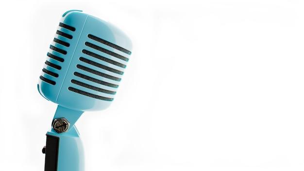 ヴィンテージマイク白い背景の上の古い青い色のマイクの写真3dイラスト