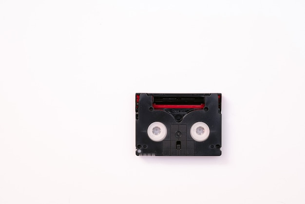 Vintage mini dv cassette tape used for recording video back in a day. plastic, magnetic, analog film tape on white background