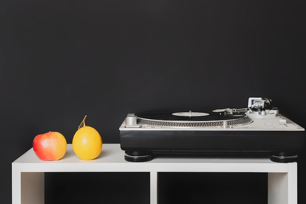 Vintage minimalistic concept with the turntable on the shelf b
