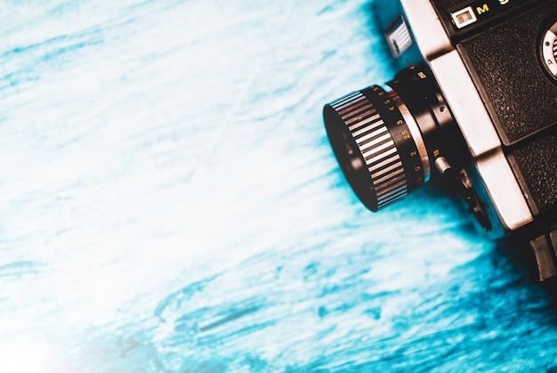 Vintage movie camera on blue background