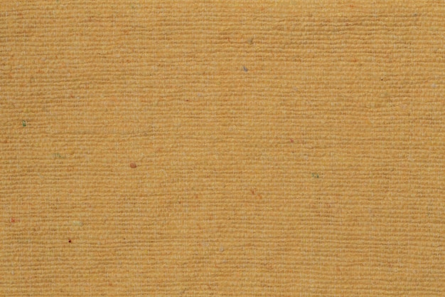 A vintage old fabric pattern and grunge background textures. background and texture yellow rustic fabric. close up