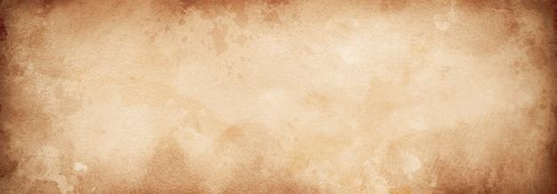 Винтажная старая бумажная предпосылка, текстура коричневой бумаги grunge или предпосылка с виньеткой.